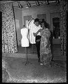 view Male dress designer at H.U. [Howard University] School of Home Economics, June 1964 [cellulose acetate photonegative] digital asset: Male dress designer at H.U. [Howard University] School of Home Economics, June 1964 [cellulose acetate photonegative].