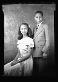 view [African American boy and girl] [black-and-white cellulose acetate photonegative] digital asset: [African American boy and girl] [black-and-white cellulose acetate photonegative].