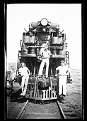 view [Three men on a locomotive] [black-and-white cellulose acetate photonegative] digital asset: [Three men on a locomotive] [black-and-white cellulose acetate photonegative].