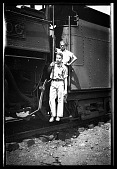 view [Two men and train] [black-and-white cellulose acetate photonegative] digital asset: [Two men and train] [black-and-white cellulose acetate photonegative].