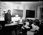 view Mr. Eubanks; Washington Jr. College of Music [#1 of 5] [photonegative,] digital asset: Mr. Eubanks; Washington Jr. College of Music [#1 of 5] [photonegative,] 1944.