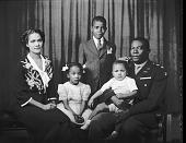view [Lt. Col. Robert L. Pollard and family, horizontal format : acetate film photonegative] digital asset: [Lt. Col. Robert L. Pollard and family, horizontal format : acetate film photonegative, ca. 1942-1945.]