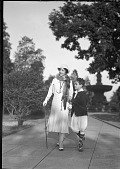 view Mme. Evanti [Lillian Evans Tibbs, with son in park, walking : acetate film photonegative] digital asset: Mme. Evanti [Lillian Evans Tibbs, with son in park, walking : acetate film photonegative].