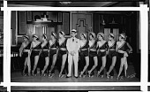 view [Club Prudhom (?) female dancers and man in center front with cane : acetate film photonegative] digital asset: [Club Prudhom (?) female dancers and man in center front with cane : acetate film photonegative, ca. 1930s?]