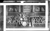 view [Coleridge Davis and his Hardy Brothers Washingtonians band, showing drums in center, with banner in the back : acetate film photonegative.] digital asset: [Coleridge Davis and his Hardy Brothers Washingtonians band, showing drums in center, with banner in the back : acetate film photonegative.]