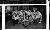 view [Prudhom Club entertainment group, man on floor holding guitar : panoramic acetate flim photonegative.] digital asset: [Prudhom Club entertainment group, man on floor holding guitar : panoramic acetate flim photonegative.]