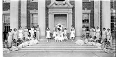 view [May Queen, Howard University: Queen and group sitting on steps of Frederick Douglas Hall : acetate film photonegative] digital asset: [May Queen, Howard University: Queen and group sitting on steps of Frederick Douglas Hall : acetate film photonegative, 1936.]