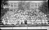 view [School group on bleachers at Dunbar High School stadium.] [acetate film photonegative] digital asset: [School group on bleachers at Dunbar High School stadium.] [acetate film photonegative, ca. 1930.]