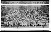 view [Graduates on bleachers, chain-link fence behind group] [panoramic acetate film photonegative] digital asset: [Graduates on bleachers, chain-link fence behind group] [panoramic acetate film photonegative, ca. 1934-1935.]