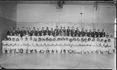 view [Cardozo High School (?) group in gym, one boy with glasses : panoramic acetate film photonegative] digital asset: [Cardozo High School (?) group in gym, one boy with glasses : panoramic acetate film photonegative, ca. 1934-1935.]