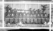 view Graduating class of Cardozo High School [group on stage with caps and gowns, plants on stage : panoramic acetate film photonegative] digital asset: Graduating class of Cardozo High School [group on stage with caps and gowns, plants on stage : panoramic acetate film photonegative], February 1935.
