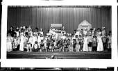 view [Children in a play, group on stage in costumes including boys dressed in frog costumes : acetate film photonegative] digital asset: [Children in a play, group on stage in costumes including boys dressed in frog costumes : acetate film photonegative, ca. 1934.]
