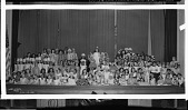 view Garrison school group (at Garnet Patterson) Dec. 1931 [group in costumes on stage : cellulose acetate photonegative, banquet camera format] digital asset: Garrison school group (at Garnet Patterson) Dec. 1931 [group in costumes on stage : cellulose acetate photonegative, banquet camera format].