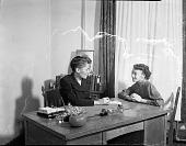 view St. Paul staff sitting at desk [from envelope?]: [acetate film photonegative,] digital asset: St. Paul staff sitting at desk [from envelope?]: [acetate film photonegative,] 1950.