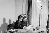 view St. Paul Staff sitting at desk [from envelope?] [acetate film photonegative] digital asset: St. Paul Staff sitting at desk [from envelope?] [acetate film photonegative], 1950.