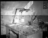 view St. Paul Staff sitting at desk [from envelope?] : [acetate film photonegative,] digital asset: St. Paul Staff sitting at desk [from envelope?] : [acetate film photonegative,] April 7, 1950.