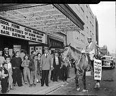 view Mr. Miller in front of the Republic Theatre [acetate film photonegative] digital asset: Mr. Miller in front of the Republic Theatre [acetate film photonegative], 4/1948.
