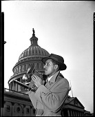 view [Robert Scurlock in front of Capitol with Speed Graphic camera : aetate film photonegative] digital asset: [Robert Scurlock in front of Capitol with Speed Graphic camera : aetate film photonegative, ca. 1940s.]