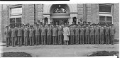 view Howard University ROTC unit, standing in front of building, with man in overcoat : acetate film photonegative digital asset: Howard University ROTC unit, standing in front of building, with man in overcoat : acetate film photonegative, ca. 1930.