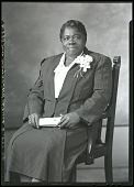 view [Mary McLeod Bethune sitting in chair, 3/4-length frontal, wearing striped suit with corsage : acetate film photonegative plus two enlarged prints,] digital asset: [Mary McLeod Bethune sitting in chair, 3/4-length frontal, wearing striped suit with corsage : acetate film photonegative plus two enlarged prints,] June 1939.