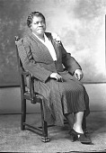 view [Mary McLeod Bethune sitting in chair, full-length, 3/4 frontal view, wearing striped suit with corsage : acetate film photonegative,] digital asset: [Mary McLeod Bethune sitting in chair, full-length, 3/4 frontal view, wearing striped suit with corsage : acetate film photonegative,] June 1939.