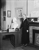 """view Dr. Anna Cooper in parlor of 201 T Street, N.W., then the Registrar's Office of Frelinghuysen University [from group of negatives entitled """"Dr. Anna J. Cooper in her garden, home & patio"""" : photonegative] digital asset: Dr. Anna Cooper in parlor of 201 T Street, N.W., then the Registrar's Office of Frelinghuysen University [from group of negatives entitled """"Dr. Anna J. Cooper in her garden, home & patio"""" : photonegative, ca. 1930]."""