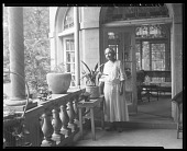 view Dr. Anna J. Cooper in her garden, home & patio [No. 12, Dr. Cooper on her patio : photonegative] digital asset: Dr. Anna J. Cooper in her garden, home & patio [No. 12, Dr. Cooper on her patio : photonegative, ca. 1930].