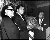 view [Muhammed Ali with Mayor Walter Washington, receiving award : color paper photoprint] digital asset: [Muhammed Ali with Mayor Walter Washington : paper photoprint, ca. 1970.]