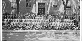 view [Posed group of young men and women in rows in front of an unidentified building : acetate film photonegative, banquet camera format.] digital asset number 1