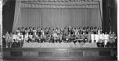 view [Children in costumes posing on stage] [panoramic cellulose acetate photonegative] digital asset: [Children in costumes posing on stage] [panoramic cellulose acetate photonegative].