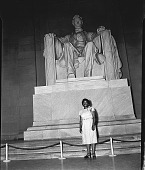 view [African American woman, identified as Carol Brice, standing in front of Lincoln statue, Lincoln Memorial : black-and-white photonegative,] digital asset: [African American woman, identified as Carol Brice, standing in front of Lincoln statue, Lincoln Memorial : black-and-white photonegative,] June, 28, 1947.