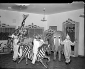 view Mrs. Dorsey-Neville Thomas School [students in circus costumes; from envelope] [acetate film photonegative,] digital asset: Mrs. Dorsey-Neville Thomas School [students in circus costumes; from envelope] [acetate film photonegative,] December 1947