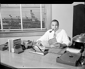 view Mr. Reason at his office [acetate film photonegative,] digital asset: Mr. Reason at his office [acetate film photonegative,] July 1949.