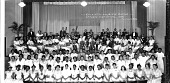view Orchestra and Girls' Chorus-- / Cardozo High School, 1936 [ink on negative]. [acetate film photonegative, banquet camera format.] digital asset: Orchestra and Girls' Chorus-- / Cardozo High School, 1936 [ink on negative]. [acetate film photonegative, banquet camera format.]