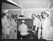 view [Young men gathered around pianist] [acetate film photonegative.] digital asset: [Young men gathered around pianist] [acetate film photonegative.] [1940-1950]
