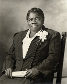 view [Mary McLeod Bethune sitting, half length, frontal, holding paper, wearing striped suit with corsage : acetate film photonegative plus two enlarged prints] digital asset: [Mary McLeod Bethune sitting, half length, frontal, holding paper, wearing striped suit with corsage : acetate film photonegative plus two enlarged prints, June 1939.]