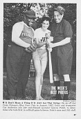 "view William ""Cat"" Anderson Collection digital asset: Duke Ellington and trumpeter Cat Anderson join JET switchboard operator Geneva Patch to determine who bats first in softball game between Duke's men and JET staff [reproduction black and white photograph]."