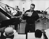 view Duke Ellington examines early manuscript of Take The A-Train, recording sssion, Hollywood, California, 1960. digital asset: Duke Ellington examines early manuscript of Take The A-Train, recording sssion, Hollywood, California, 1960.