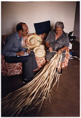 view Teodoro Vidal Collection digital asset: Photo of Teodoro Vidal and unidentified woman making a Pava hat.