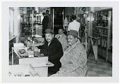 view Benny Carter, Coleman Hawkins, and John Levy in camera shop, Frankfurt, Germany, 1961 [black and white photoprint] digital asset: Benny Carter, Coleman Hawkins, and John Levy in camera shop, Frankfurt, Germany, 1961 [black and white photoprint].
