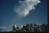 view [Soldiers standing in desert with atomic bomb cloud over their heads : 35mm color slide] digital asset: [Soldiers standing in desert with atomic bomb cloud over their heads : 35mm color slide].