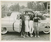 view [Four young African American women standing beside a convertible automobile : black-and-white photoprint] digital asset: [Four young African American women standing beside a convertible automobile : black-and-white photoprint].