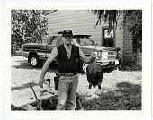view Mike Musgrave ready to butcher a snapping turtle, Ohio [black-and-white photoprint], 2003 digital asset number 1