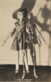 view [Articulated, skeletal manikin with girl manikin : black-and-white photoprint] digital asset: [Articulated, skeletal manikin with girl manikin : black-and-white photoprint, 1930s.]