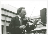 view Claude Williams performing in Cheltenham, England, 1988. [Black and white photoprint] digital asset: Claude Williams performing in Cheltenham, England, 1988. [Black and white photoprint].