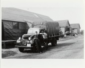 view Edwin Strakna at army truck on temp duty at Fort Deven's, MA, 1940. [Black-and-white photoprint.] digital asset: Edwin Strakna at army truck on temp duty at Fort Deven's, MA, 1940. [Black-and-white photoprint.]