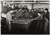 view [Men standing around a pool table while one prepares to shoot. Camp Smith : black-and-white photoprint] digital asset: [Men standing around a pool table while one prepares to shoot. Camp Smith : black-and-white photoprint, ca- 1933-1942.].