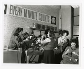 view Every Minute Counts, garment workers on the home front, New York [black-and-white photoprint] digital asset: Every Minute Counts, garment workers on the home front, New York [black-and-white photoprint], 1942.