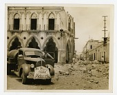 view [Truck and street, showing earthquake damage to buildings in Colima, Mexico : black-and-white photoprint] digital asset: [Truck and street, showing earthquake damage to buildings in Colima, Mexico : black-and-white photoprint], 1932.