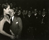 view Goodwill Fiesta Farewell Gala: Norma Shearer and Mickey Rooney, Mexico City, 1941 [black-and-white photoprint] digital asset: Goodwill Fiesta Farewell Gala: Norma Shearer and Mickey Rooney, Mexico City, 1941 [black-and-white photoprint].